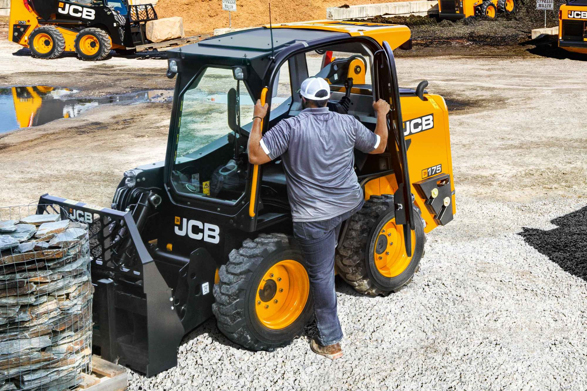 With our side door entry, operators no longer need to climb over large  attachments or under an unsupported boom.
