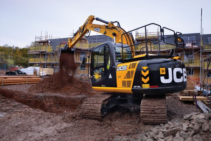Tracked excavator, application, housing development